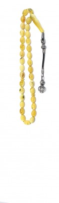 Yellow natural amber worry beads in traditional style.