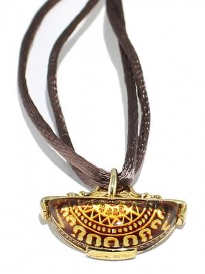 Natural back engraved amber pendant.