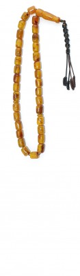 Worry beads set, made of dark Yellow natural amber, with darker and lighter shades of Brown.